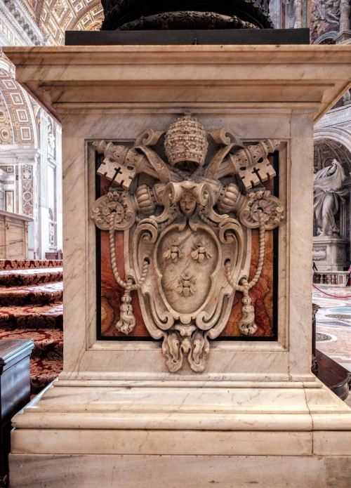 Coat of arms of Pope Urban VIII at the base of one of the pillars of the baldachin of St. Peter, Basilica of San Pietro in  Vaticano