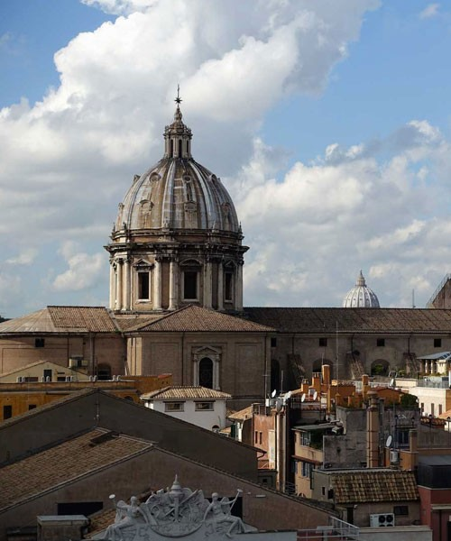 Dome of the Basilica of Sant'Andrea della Valle, in the background the dome of St. Peter's Basilica