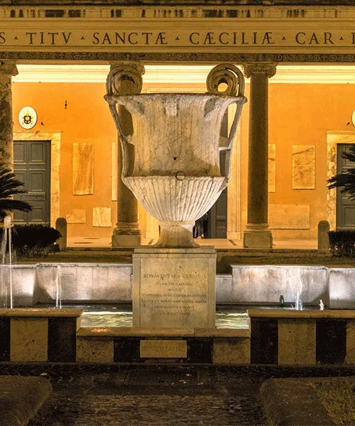 Fountain in front of the Basilica of Santa Cecilia, arrangements from the XX century