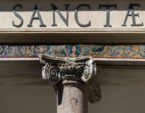 Basilica of Santa Cecilia, mosaic frieze in the portico of the church façade with image of St. Cecilia