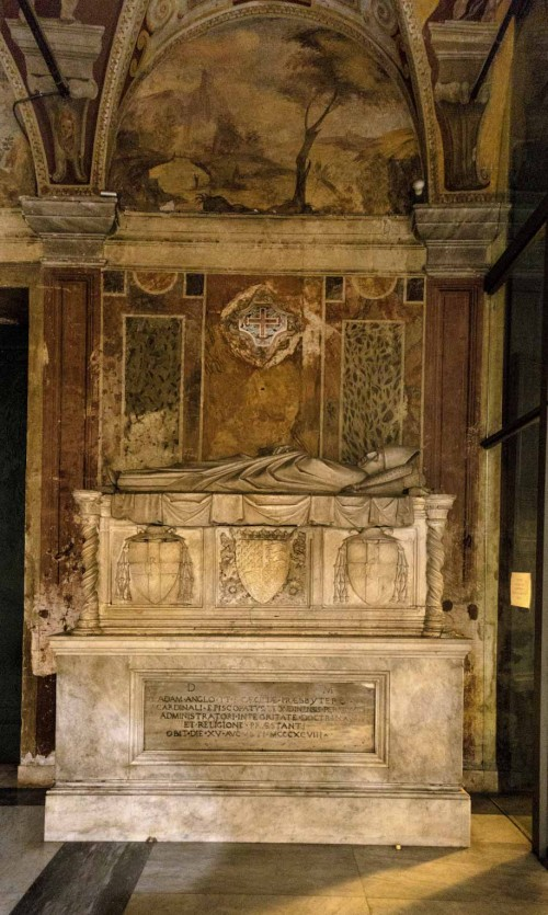 Basilica of Santa Cecilia, tombstone of Adam Easton, frescoes of the church vestibule in the background
