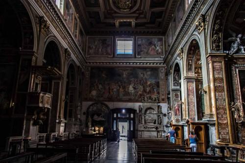 Church of San Marcello, interior with a view of the main enterance, in the lintel scene of the Crucifixion, Giovanni Battista Ricci