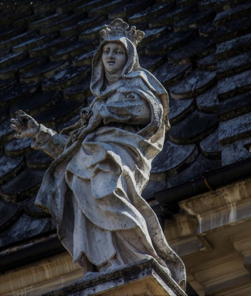Church of Santa Maria dei Miracoli, statue of a saint on the building elevation
