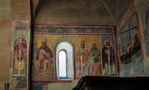Basilica of Santi Quattro Coronati, entrance wall, frescoes from the XIV century, Bishop Rainaldus, St. Augustine and three other saints