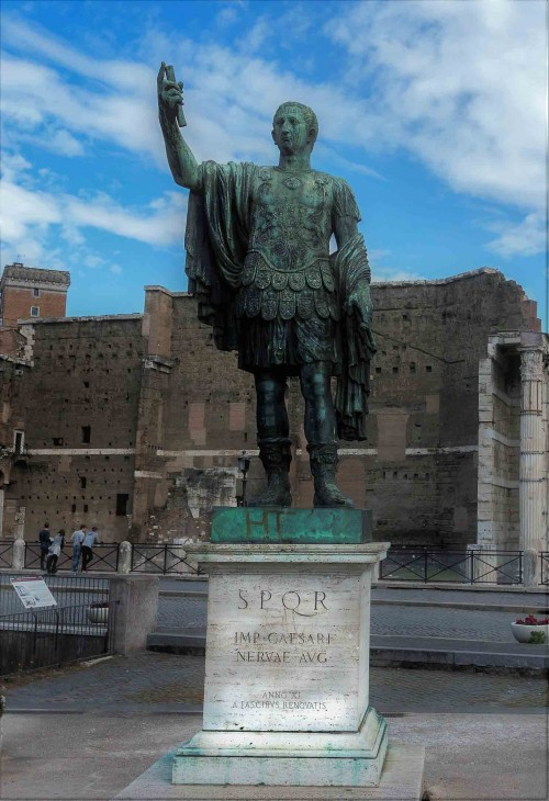 Statue of Emperor Nerva (contemporary) at via dei Fori Imperiali, Trajan's Forum in the background