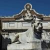 Piazza del Popolo, Lion from the fountain at the Flaminio Obelisk, Porta del Popolo in the background