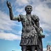 Statue of Emperor Trajan (replica), Forum of Trajan in the background