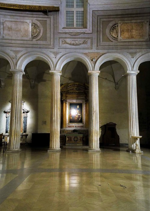 Basilica of San Pietro in Vincoli, row of Doric columns from the V century, the Altar of St. Augustine in the  background