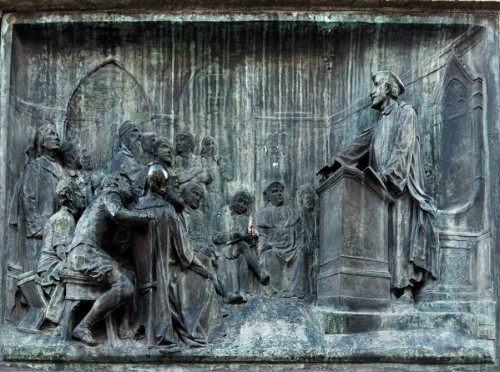 Statue of Giordano Bruno, relief depicting the philosopher teaching at Oxford