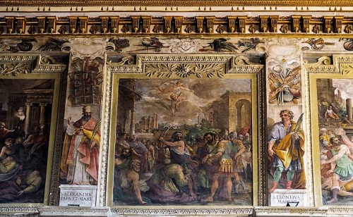 Basilica of Santi Cosma e Damiano, frieze under the ceiling with the story of the first martyrs, XVIII century