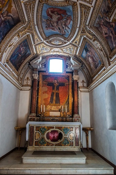 Church of Santi Cosma e Damiano, chapel with a fresco from the XIII century depicting Christ the King Crucified. Fragment of an ancient porphyry column below