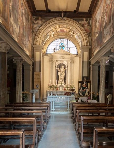 Interior of the Church of Santa Bibiana with a statue of St. Bibiana in the apse