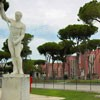 Foro Italico, statue adorning the tennis court, in the background facilities of the swimming center